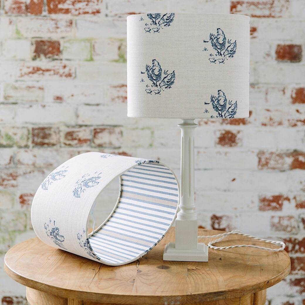 A 30cm oval drum shade in an Emily Bond print backed with a vintage deckchair stripe